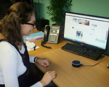 Informed Choice team member Alice Cranwell testing the new Alexa Flash Briefing sysem