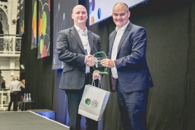 Paul Hennessy, group operations manager at Financial Planner LEBC, awarded e-Adviser of the Year by Hamish Purdey, chief executive of Intelliflo