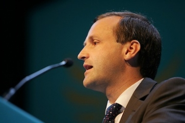 Sir Steve Webb speaking at an industry conference