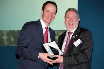 Stuart Robinson (left) receives his award