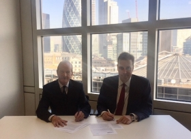 Lord Hunt of Wirral and Andy Briggs sign the agreement