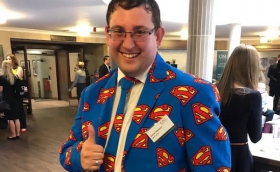Conference Co-chair Dan Atkinson in his Superman business suit for the Superhero-themed CISI / IFP Paraplanning Conference