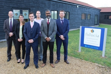 Fiducia Wealth Management advisors celebrate achieving Corporate Chartered Financial Planner status