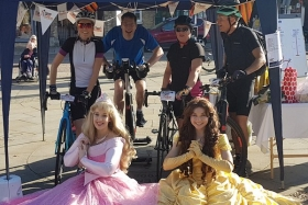 The Beacon charity cyclists (joined by some 'princesses') at the event earlier this month